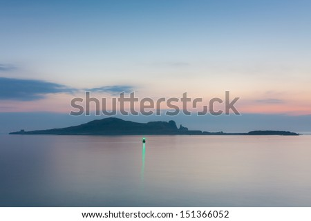 Ireland's Eye at twilight long exposure image - stock photo