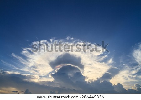 Iridescent pileus cloud or irisation clouds. The beautiful natural phenomenon - stock photo