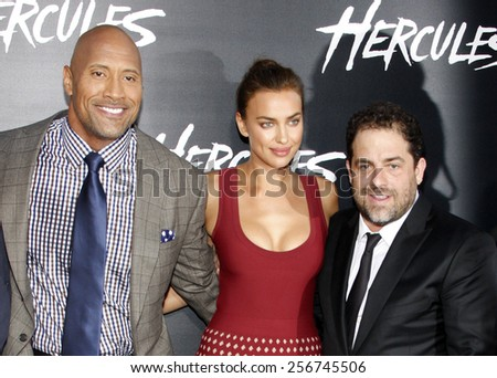 "Irina Shayk, Dwayne Johnson and Brett Ratner at the Los Angeles premiere of ""Hercules"" held at the TCL Chinese Theatre in Los Angeles on July 23, 2014 in Los Angeles, California.  - stock photo"