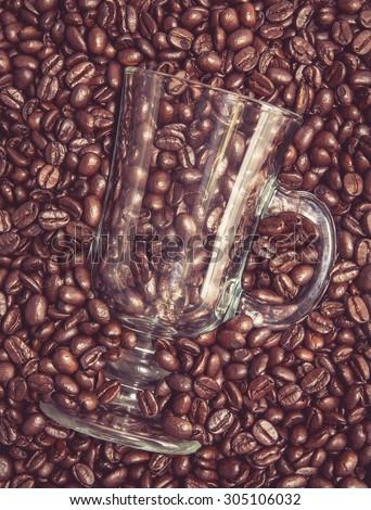 Irish coffee glass stuck in fresh coffee beans - stock photo