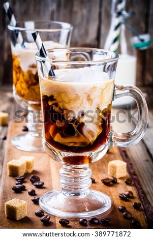 Irish coffee in mugs on wooden table - stock photo