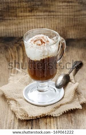 Irish coffee on wooden table  - stock photo