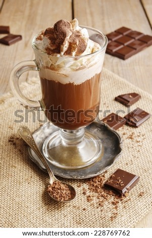 Irish coffee on wooden table - stock photo