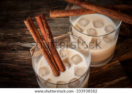 Irish cream liqueur in a glass with ice and cinnamon - stock photo