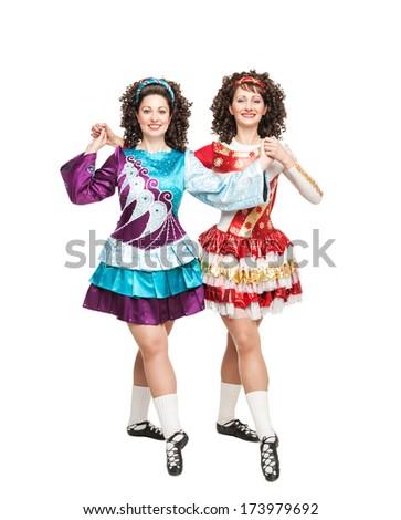 Irish dancers posing isolated - stock photo