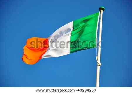 Irish Flag waving in the wind - stock photo