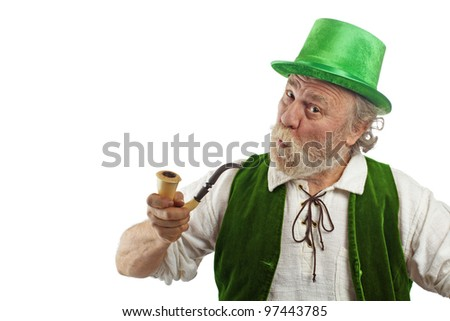 Irish leprechaun with white beard, top hat, and green velvet vest. He holds up curved pipe, raises eyebrows, purses lips and tilts head. Isolated on white, horizontal layout with copy space. - stock photo