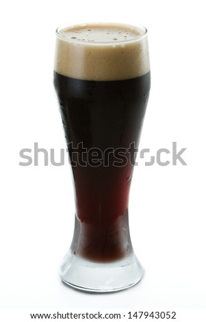 irish stout isolated on a white background served in a cold glas - stock photo