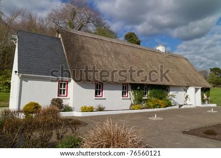 Irish traditional cottage house at Ashford castle - stock photo