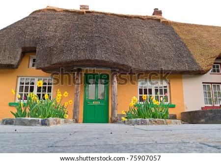 Irish traditional cottage house in Adare - landmark - stock photo