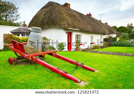 Irish traditional cottage houses in Adare village - stock photo