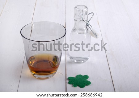 Irish whiskey in a glass with a small bottle filled with tap water - stock photo