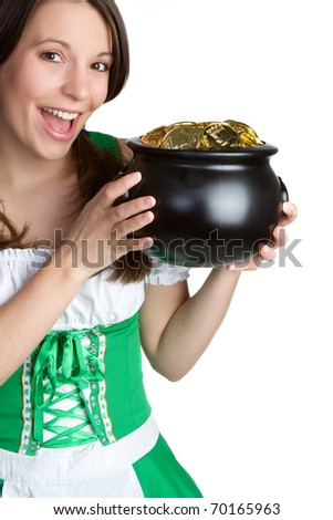 Irish woman holding pot of gold - stock photo