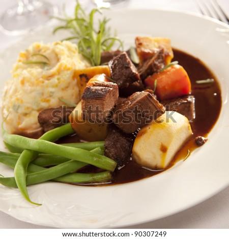 Irisha lamp stew with carrots and beans - stock photo