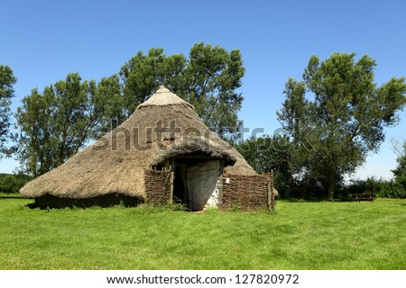 Iron Age House. Reconstruction of an iron age roundhouse. - stock photo