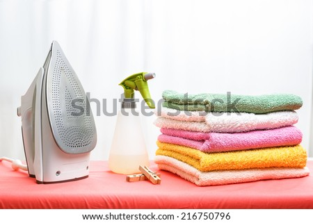 iron and laundry on the ironing board - stock photo