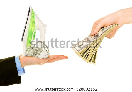 Iron and money on hands - pawnshop concept - stock photo