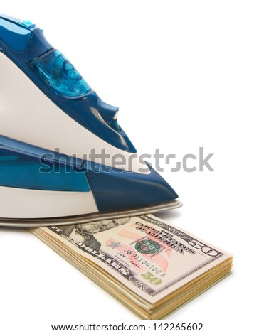 Iron and pack of dollar banknotes. - stock photo