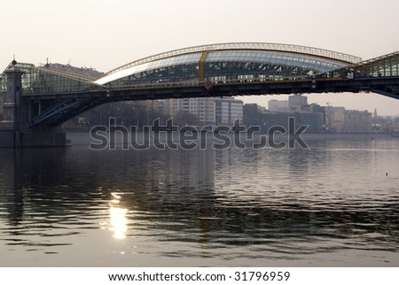 Iron bridge and sun on the river in Moscow - stock photo