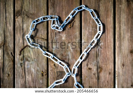 Iron chain formed into a heart. - stock photo
