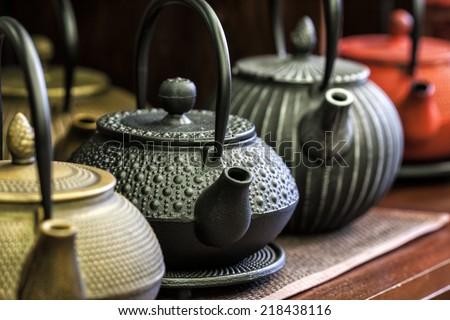 Iron Chinese teapots. - stock photo