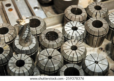 Iron details - shafts bolts nuts and cylinders. Metal engineering. Lathe milling and drilling technology. CNC industry. - stock photo