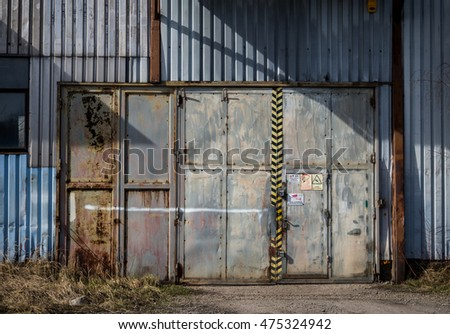 Iron entrance doors to old blue warehouse