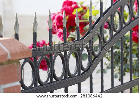 Iron Fence. Forge Detail. Part of a wrought iron fence. Iron gate details. - stock photo