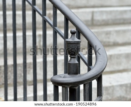 Iron handrail, volute and finial detail - stock photo