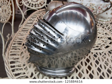 Iron helmet of the medieval knight at flea market in Paris. - stock photo