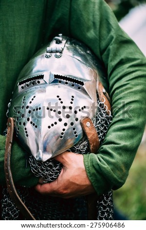 Iron Helmet Of The Medieval Knight. Helmet Of A Medieval Suit Of Armour In Hands - stock photo