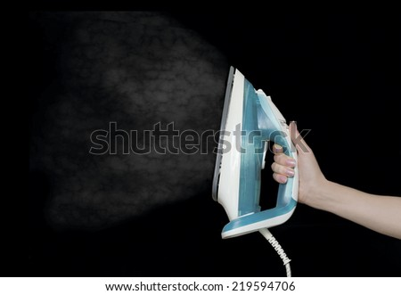 iron in a hand - stock photo