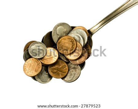 Iron kitchen spoon with coins, closeup. Go out and slap up dinner. - stock photo