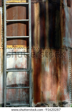 iron ladder on the metal cylinder - stock photo
