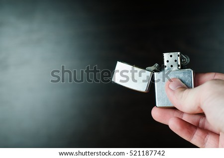 Iron lighter in hand