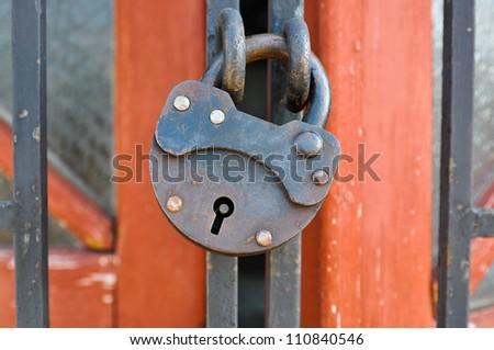 Iron lock hangs on a lattice closed - stock photo