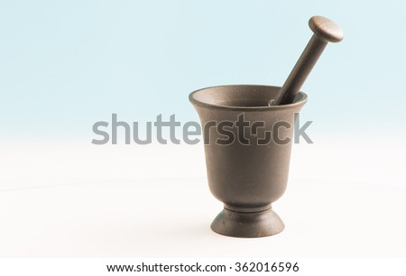 Iron mortar and pestle. Kitchen utensil for food preparation.