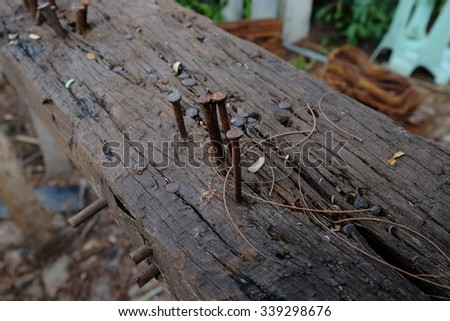 Iron nails on a wooden stick