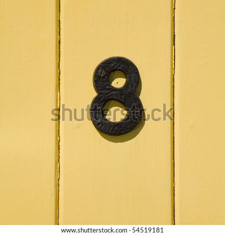 iron number eights on yellow planking background - stock photo