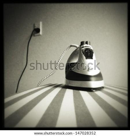 Iron on ironing board  - stock photo