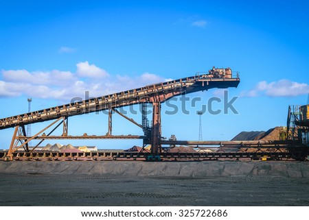 Iron ore conveyor in steel industry, UK - stock photo