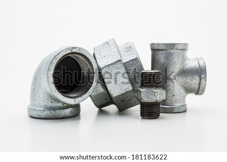 Iron pipe fittings for plumbing isolated on white background.  - stock photo