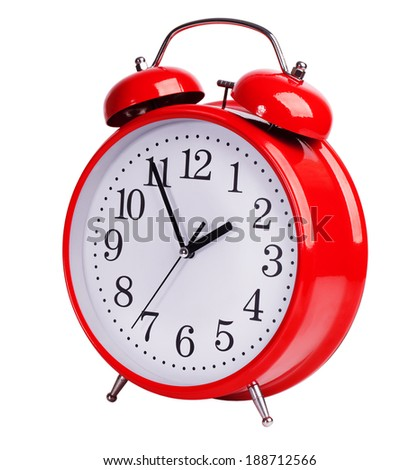 Iron red alarm clock on white background