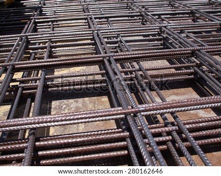 Iron steel bars construction material used to reinforce concrete - stock photo