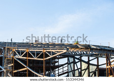 Iron workers on top of building under construction