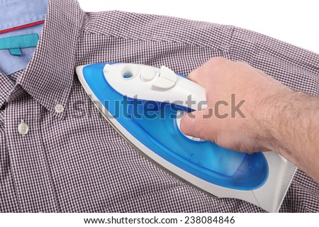 Ironing a shirt on white background - stock photo
