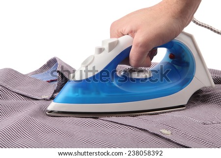 Ironing a shirt with a steam iron on white background - stock photo