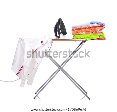 ironing board with a man's shirt and a household iron - stock photo