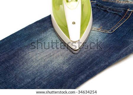 Ironing jeans on a white baclground - stock photo