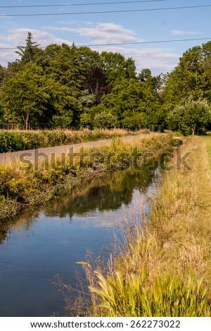 Irrigation canal, Po Valley , Novara , Piedmont , Italy - stock photo
